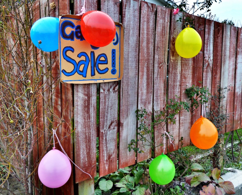 fence with garage sale sign